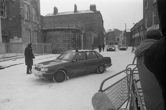 Peter Robinson At Special Criminal Court.  (R48)..1987..13.01.1987..01.13.1987..13th January 1987..Following a masked incursion into Clontibret, Co Monaghan,Ulster politician Peter Robinson and two others were charged by the police. The incursion was to highlight Unionist opposition to the Anglo Irish Agreement. As a result Mr Robinson faced the Special Criminal Court In Dublin. Mr Robinson was convicted for unlawful assembly and fined £17,500. Charges relating to assault on Gardai and malicious damages were dropped. Afterwards Mr Robinson said that he was thankful to the court for not imposing a custodial sentence...Image shows the car containing Peter Robinson arriving at the Special Criminal Court, Green Street,Dublin.