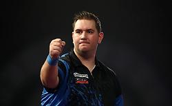 Kevin Munch celebrates during his match against Toni Alcinas during day eleven of the William Hill World Darts Championship at Alexandra Palace, London.