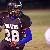 101212       Cable Hoover<br /> <br /> Grants Pirate Timothy White (28) carries the ball against the Miyamura Patriots Friday at Grants High School.