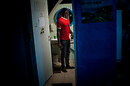 A migrant looks in the mirror after he gets his hair cut in Lakaxita. Irun (Basque Country). August 30, 2018. Lakaxita is a self-managed socio-cultural space located in an occupied house, where volunteers have created a hosting network for migrants in transit who have already completed the 5-day period that can remain in public resources. This group of volunteers is avoiding a serious humanitarian problem Irún, the Basque municipality on the border with Hendaye. As the number of migrants arriving on the coasts of southern Spain incresead, more and more migrants are heading north to the border city of Irun. (Gari Garaialde / Bostok Photo)