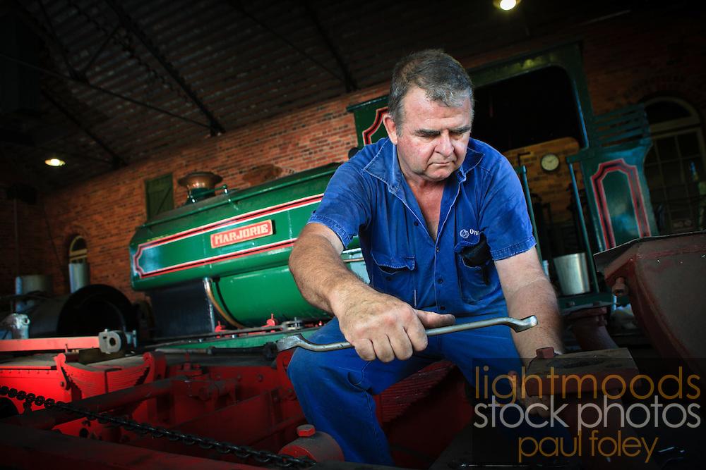 Volunteer restoring Steam Locomotive at Richmond Vale Rail Museum, Hunter Valley, NSW, Australia