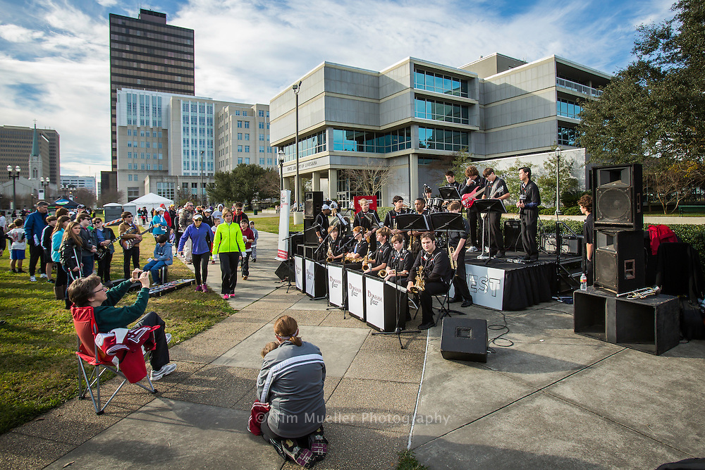 Dow employees participate Saturday, Jan. 19, 2013 in The Advocate Cyress 5K run in downtown Baton Rouge, La.