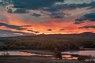 Sunrise clouds over Maskinonge Lake in Waterton Lakes National Park, Alberta, Canada