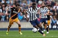 Fred Onyedinma of Millwall runs past Romain Vincelot, the Bradford City captain. EFL Skybet football league one match, Millwall v Bradford city at The Den in London on Saturday 3rd September 2016.<br /> pic by John Patrick Fletcher, Andrew Orchard sports photography.