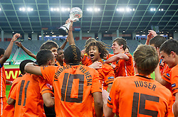 Nathan Ake and other players of Netherlands celebrate with a trophy after winning the UEFA European Under-17 Championship Final match between Germany and Netherlands on May 16, 2012 in SRC Stozice, Ljubljana, Slovenia. Netherlands defeated Germany after penalty shots and became European Under-17 Champion 2012. (Photo by Vid Ponikvar / Sportida.com)
