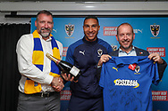 AFC Wimbledon defender Terell Thomas (6) receiving man of match award during the EFL Sky Bet League 1 match between AFC Wimbledon and Lincoln City at the Cherry Red Records Stadium, Kingston, England on 2 November 2019.