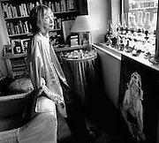 """Author Joan Didion in her New York City apartment with a portrait of her daughter Qunitanna , her only child, who died a few days after this photo was taken. Didion had just written a best-selling memoir """" The Year of Magical Thinking"""", based on her personal experiences dealing with grief following the sudden death of her husband, author John Gregory Dunne, the previous year. Qunitanna was in a coma at the time of Dunn's death, and had to be told of his death by Didion when she awoke."""