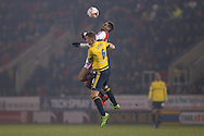 Rotherham United forward Leon Best (50)  gets high above Middlesbrough defender Ben Gibson (6)  during the Sky Bet Championship match between Rotherham United and Middlesbrough at the New York Stadium, Rotherham, England on 8 March 2016. Photo by Simon Davies.