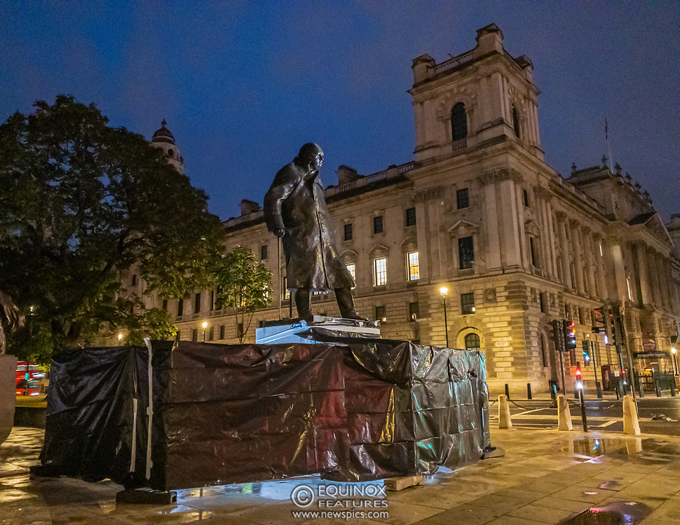 London, United Kingdom - 17 June 2020<br /> Police guard Winston Churchill statue. Its graffiti was being cleaned with solvents after the statue was uncovered from its protective scaffolding and sheet metal following Black Lives Matter protests, Parliament Square, London, England, UK.<br /> (photo by: EQUINOXFEATURES.COM)<br /> Picture Data:<br /> Photographer: Equinox Features<br /> Copyright: ©2020 Equinox Licensing Ltd. +443700 780000<br /> Contact: Equinox Features<br /> Date Taken: 20200617<br /> Time Taken: 22271467<br /> www.newspics.com