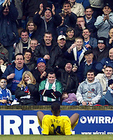 Photo: Scott Heavey.<br />Millwall v Tranmere Rovers. FA Cup 6th Round. 07/03/2004.<br />The Millall fans share a joke with Eugene Dadi