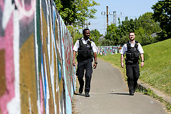 © Licensed to London News Pictures. 06/05/2020. London, UK. Police officers patrol Markfield Park, Tottenham in north London. The coronavirus lockdown continues to slow the spread of COVID-19 and reduce pressure on the NHS.  Photo credit: Dinendra Haria/LNP