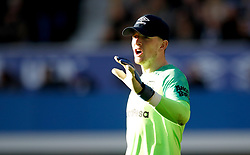 Everton goalkeeper Jordan Pickford wears a baseball cap to shield his eyes from the sun