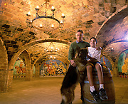 Darryl Sattui with his son Mario, 11, and German Shepard, Lupo, in the cavern of their Napa Valley Castle which is part of the Sattui Winery in Northern California. Calistoga. MODEL RELEASED..