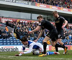 Blackburn's Bradley Dack is bundled over by Wigan's Callum Elder