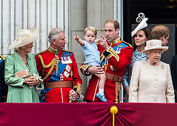© London News Pictures. 13/06/2015. London, UK. L to R Camilla Duchess of Cornwall, Prince Charles,  Prince George of Cambridge being held up by his father Prince William, Catherine Duchess of Cambridge, Queen Elizabeth II and Prince Harry.  Members of the Royal Family on the balcony of Buckingham Palace during the annual Trooping the Colour Ceremony in central London. The event marks the queens official birthday. .Photo credit: Ben Cawthra/LNP