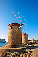 Windmills and walls of Rhodes, Greece. UNESCO World Heritage Site .<br /> <br /> Visit our GREEK HISTORIC PLACES PHOTO COLLECTIONS for more photos to download or buy as wall art prints https://funkystock.photoshelter.com/gallery-collection/Pictures-Images-of-Greece-Photos-of-Greek-Historic-Landmark-Sites/C0000w6e8OkknEb8