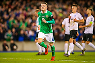 Northern Ireland midfielder Steven Davis scores a goal from the penalty spot and celebrates 2-0 during the UEFA European 2020 Qualifier match between Northern Ireland and Estonia at National Football Stadium, Windsor Park, Northern Ireland on 21 March 2019.