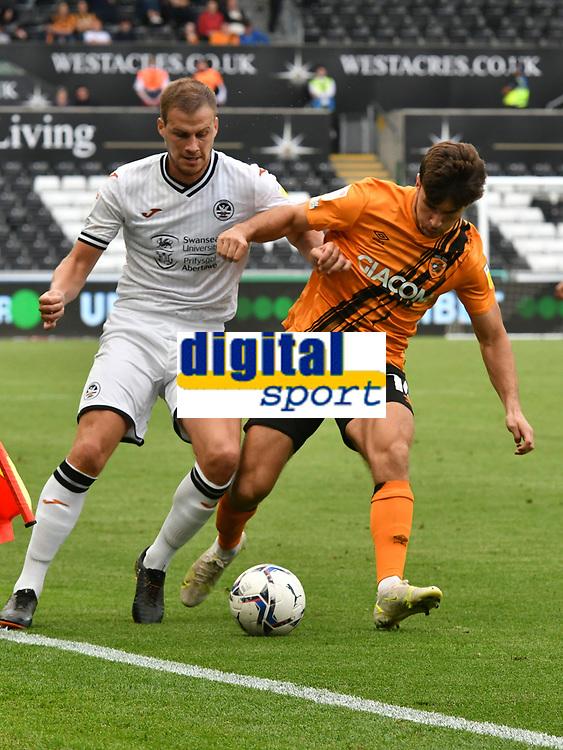 Football - 2021 / 2022 EFL Sky Bet Championship - Swansea City vs Hull City - Liberty Stadium - <br /> <br /> Ryan Longman Hull City & Ryan Bennett Swansea City<br /> <br /> COLORSPORT/WINSTON BYNORTH