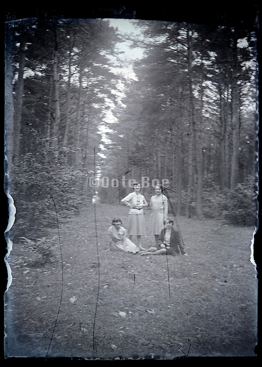 women on a large open lane in the woods France circa 1930s