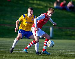 Cowdenbeath's Jamie Todd and Broxburn Athletic's Alexander Miller. half time : Broxburn Athletic FC 1 v 0 Cowdenbeath, William Hill Scottish Cup 2nd Round replay played 26/10/2019 at Albyn Park, Greendykes Road, Broxburn.