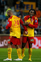 FOOTBALL - FRENCH CHAMPIONSHIP 2010/2011 - L1 - OLYMPIQUE MARSEILLE v RC LENS - 13/11/2010 - PHOTO PHILIPPE LAURENSON / DPPI - JOY AFTER MATCH ERIC CHELLE (LEN) AND SERGE AURIER (LEN)