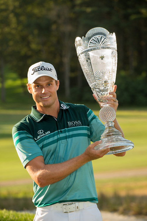 FARMINGDALE, NY - AUGUST 26:  Nick Watney holds the champion's trophy after winning the 2012 Barclays at the Black Course at Bethpage State Park in Farmingale, New York on August 26, 2012. (Photograph ©2012 Darren Carroll) *** Local Caption *** Nick Watney