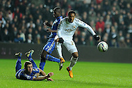 Swansea city's Jonathan de Guzman has a shot at goal blocked by Chelsea's Gary Cahill (l). Capital one cup semi final, 2nd leg, Swansea city v Chelsea at the Liberty Stadium in Swansea on Wednesday 23rd Jan 2013. pic by Andrew Orchard, Andrew Orchard sports photography,