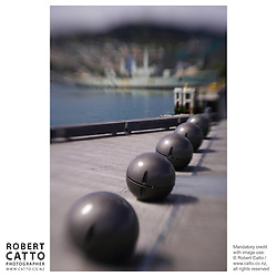 Light fittings in the form of balls line Lambton Harbour in Wellington New Zealand.