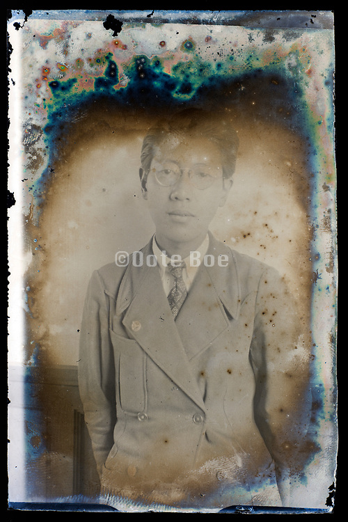 deteriorating glassplate with portrait of a young adult man Japan ca 1930s