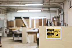 March 4, 2018 - Interior of a woodworking factory showing a sign for safety gear regulations. (Credit Image: © Mint Images via ZUMA Wire)