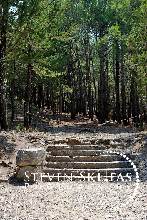 Staircase linking the third level terrace to the sacred grove. This image was captured at the Asklepieion, the sanctuary of Asklepios, the Greek god of medicine and healing and son of Apollo. It lays 3.5 kilometers north-west of Kos Town and stands on the slopes of a low hill and enjoys a superb view over the sea and the coast of Asia Minor (Turkey) opposite.