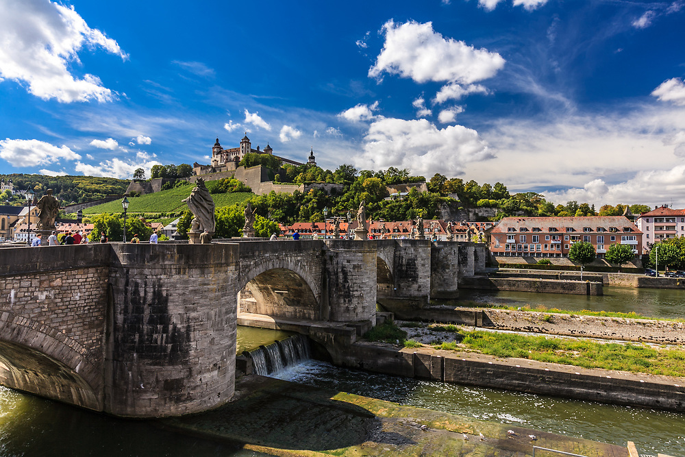 Old Main Bridge in Würzburg, Germany. With six huge statues of saints in niches on each side of the thoroughfare, this pedestrian bridge is memorable.