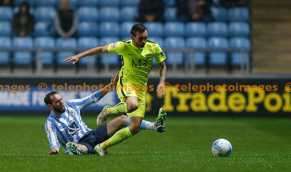 Southend's David Worrall is fouled by Jim O'Brien of Coventry during the Sky Bet League 1 match between Coventry City and Southend United at the Ricoh Arena in Coventry. August 31, 2015.<br /> James Boardman / Telephoto Images<br /> +44 7967 642437