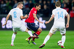 Jasmin Kurtic of Slovenia vs Mohammed Abdellaoue of Norway during the FIFA World Cup 2014 Group E qualification match between Slovenia and Norway on October 11, 2013 in Stadium Ljudski vrt, Maribor, Slovenia. (Photo by Urban Urbanc / Sportida)