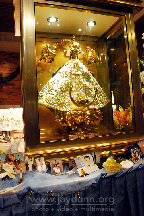 """United States, Illinois, Chicago, September 25, 2009. Since 1623, the revered figure of """"Nuestra Senora de los Lagos,"""" or """"Our Lady of San Juan de los Lagos"""" in Jalisco, Mexico has provided comfort and miracles for those who believe. Sometimes known as """"The Traveling Virgin,"""" for seven days she graced the Church of the Good Shepherd in Little Village, and hundreds of Catholics came from miles around to pay their respects."""