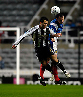 Photo: Jed Wee.<br /> Newcastle United v Portsmouth. Carling Cup. 25/10/2006.<br /> <br /> Portsmouth's Andy O'Brien (R) wins a header from Newcastle's Giuseppe Rossi.