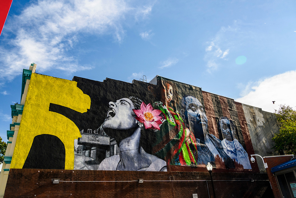 Baltimore, Maryland - October 09, 2020: The mural at the intersection of Pennsylvania and North Avenues depicts Billie Holiday, The Met Theatre, author Ta-Nehisi Coates with his son, and muralist Ernest Shaw Jr.'s daughter.<br /> CREDIT: Matt Roth for Baltimore Magazine
