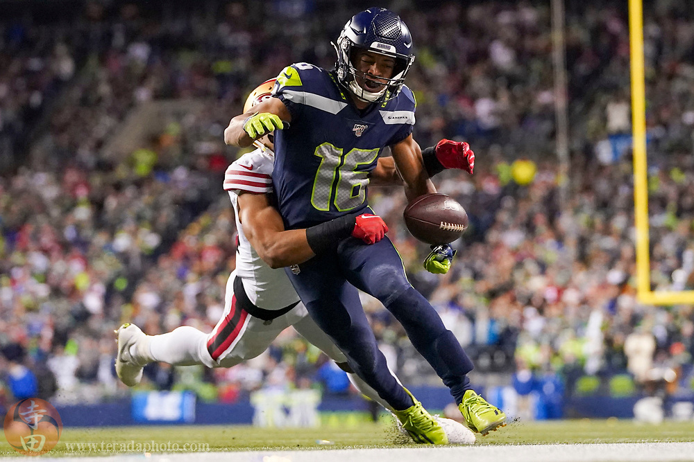 December 29, 2019; Seattle, Washington, USA; Seattle Seahawks wide receiver Tyler Lockett (16) is tackled by San Francisco 49ers defensive back K'Waun Williams (24) during the fourth quarter at CenturyLink Field.