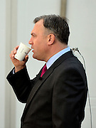 © Licensed to London News Pictures. 01/10/2012. Manchester, UK Shadow Chancellor Ed Balls drinks coffee as he prepares to speak to the media on the morning of his conference speech. Labour Party Conference Day 2 at Manchester Central. Photo credit : Stephen Simpson/LNP