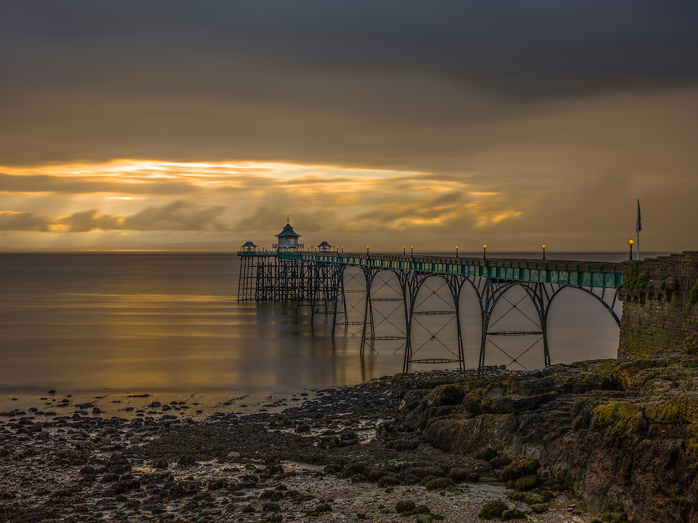 Limited Editions of 8<br /> Clevedon Pier breaking storm and a teasing cloud break with Golden Sunset
