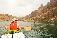Canoers and kayakers navigate the Colorado River through The Black Canyon, Nevada.