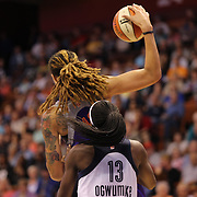Brittney Griner, Phoenix Mercury, is defended by Chiney Ogwumike, Connecticut Sun during the Connecticut Sun Vs Phoenix Mercury WNBA regular season game at Mohegan Sun Arena, Uncasville, Connecticut, USA. 12th June 2014. Photo Tim Clayton