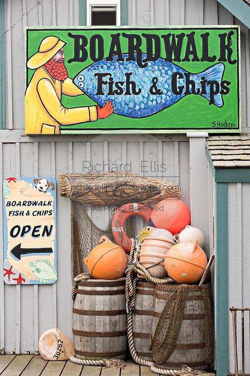 Quirky sign for a Fish & Chips shop along the marsh boardwalk on Homer Spit on Kamishak Bay in Homer, Alaska.
