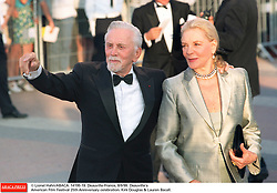 Kirk Douglas Dies At 103 - © Lionel Hahn/ABACA. 14195-19. Deauville-France, 8/9/99. Deauville's American Film Festival 25th Anniversary celebration. Kirk Douglas & Lauren Bacall.