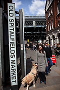 Spitalfields Market, London. This historic market, which sold 'flesh, fowl and roots' as decreed in 1638 by the then King, now is a thriving market selling anything from clothes to food and crafts.