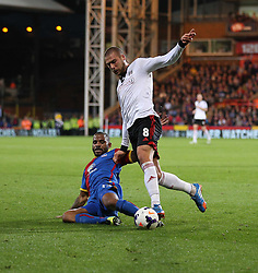 Crystal Palace's Jason Puncheon tackles Fulham's Pajtim Kasami - Photo mandatory by-line: Robin White/JMP - Tel: Mobile: 07966 386802 21/10/2013 - SPORT - FOOTBALL - Selhurst Park - London - Crystal Palace V Fulham - Barclays Premier League