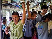 31 MAY 2017 - CHACHOENGSAO, THAILAND: Passengers on a Bangkok-Chachoensao commuter train. Chachoengsao is a provincial town about 50 miles and about an hour by train from Bangkok. The train from Chachoengsao to Bangkok takes a little over an hour but traffic on the roads is so bad that the same drive can take two to three hours. Thousands of Thais live outside of Bangkok and commute into the city for work on trains, busses and boats.       PHOTO BY JACK KURTZ