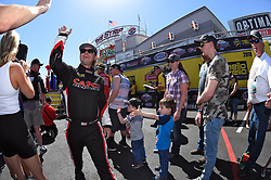 April 8, 2018 - Las Vegas, NV, U.S. - LAS VEGAS, NV - APRIL 08: Steve Torrence (2 TF) NHRA Top Fuel Dragster high fives the fans as he walks off the stage for driver intros during the DENSO Spark Plugs NHRA Four-Wide Nationals on April 08, 2018 at The Strip at Las Vegas Motor Speedway in Las Vegas, NV. (Photo by Chris Williams/Icon Sportswire) (Credit Image: © Chris Williams/Icon SMI via ZUMA Press)