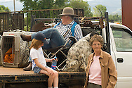 Kids and grandparents watch Montana Mule Days parade in Drummond Montana