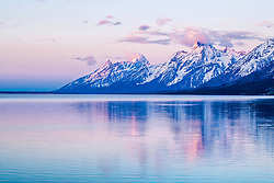 """Grand Teton sunrise from Jackson Lake Overlook.  The Grand Tetons reflect upon the rarely calm water of Jackson Lake in Grand Teton National Park.<br /> <br /> For production prints or stock photos click the Purchase Print/License Photo Button in upper Right; for Fine Art """"Custom Prints"""" contact Daryl - 208-709-3250 or dh@greater-yellowstone.com"""